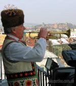 "The trumpeter, dressed in folk Ukrainian costume, plays ""Marichka"" on the clock tower of the City Hall."